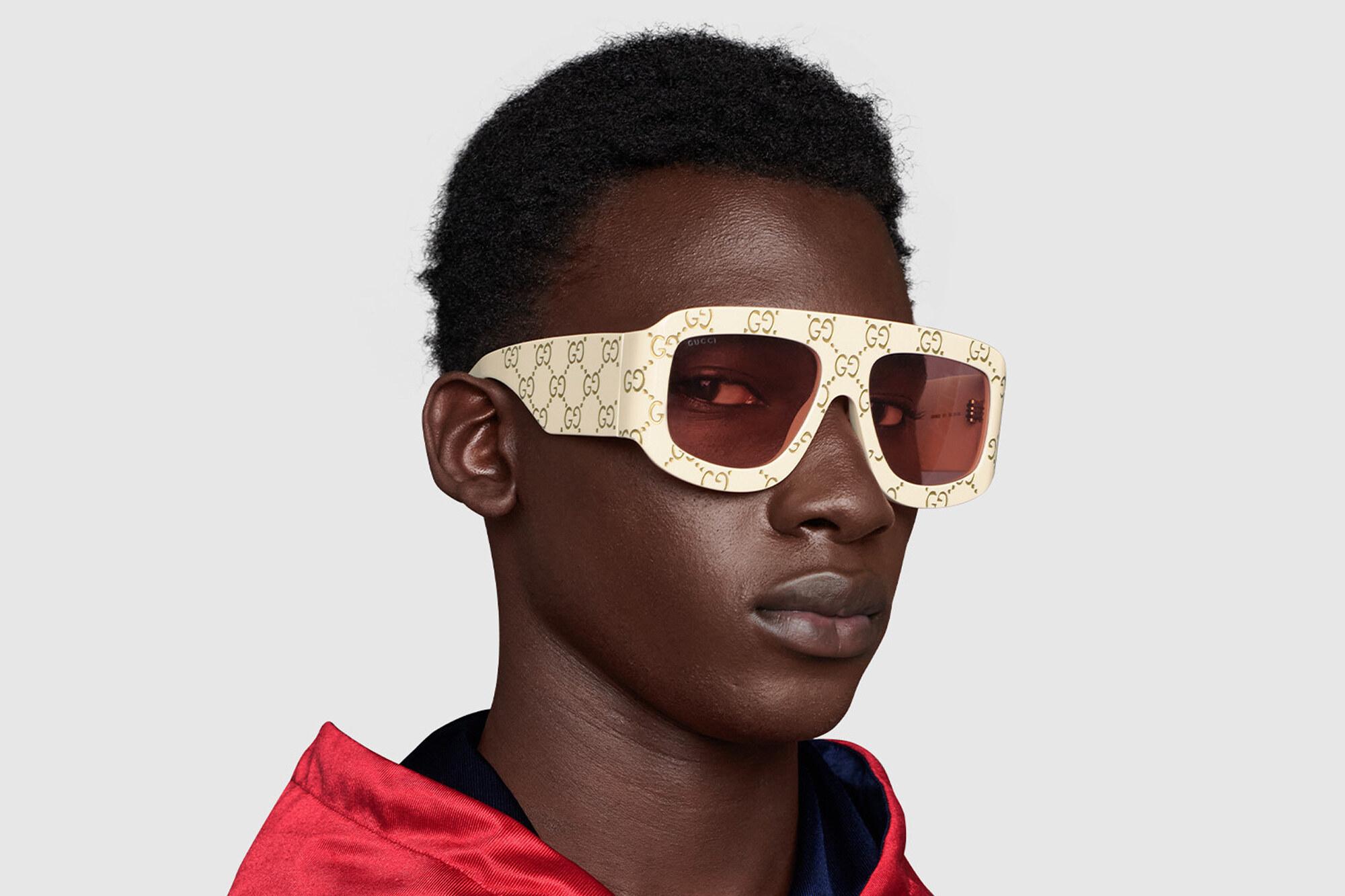 Gucci Occhiali da sole rettangolari con motivo GG